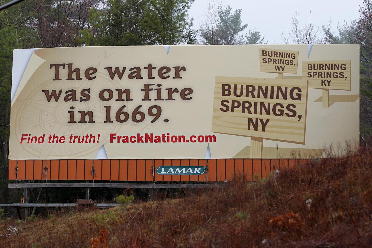 "COMMERCIAL IMAGE - In this photograph taken by AP Images for FrackNation, this new eye-opening billboard was unveiled today in natural-gas rich New York near the Pennsylvania border. The aggressive billboard shatters claims by environmentalists and anti-fracking filmmaker Josh Fox, that natural gas production has caused local tap water to become flammable. The billboard promotes the controversial documentary FrackNation, which is being called 'an answer to Gasland.' The ""exploding faucet"" is one of the most widely viewed images in the Oscar nominated, anti-fracking documentary Gasland and the billboard dramatically points out historic records that state ""The water was on fire in 1669."" The Billboard also features township signs for Burning Springs, N.Y., Burning Springs, W.V. and Burning Springs, K.Y. where residents obviously knew their water could be set on fire centuries before natural gas production began. ""As journalists, we felt it was important to bring to light the truth and counter the common, inaccurate scare stories about 'exploding' tap water,"" said McAleer. (Adam Hunger/AP Images for FrackNation)"