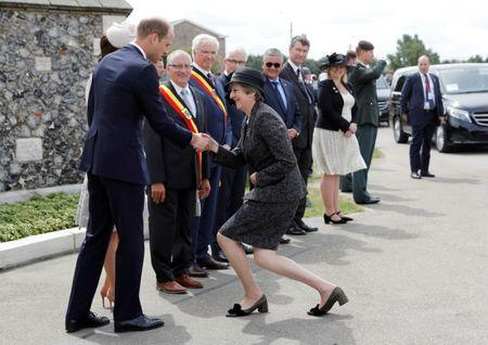 FILE PHOTO: Britain's Prime Minister Theresa May greets Prince William and Catherine the Duchess of Cambridge as she arrives at Tyne Cot cemetery for commemorations for the 100th anniversary of the battle of Passchendaele near Ypres in Belgium, July 31, 2017. REUTERS/Darren Staples/File Photo