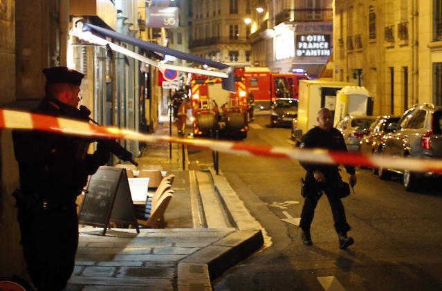 <p>Police officers cordon off the area after a knife attack in central Paris, Saturday May 12, 2018. (Photo: Thibault Camus/AP) </p>