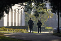 FILE - In this Jan. 14, 2021, file photo, California Highway Patrol officers patrol the grounds of the state Capitol in Sacramento, Calif. Law enforcement officials are investigating escalating threats of death and violence against California Gov. Gavin Newsom, his family and the the wineries, shops and other businesses he founded. (AP Photo/Rich Pedroncelli, File)