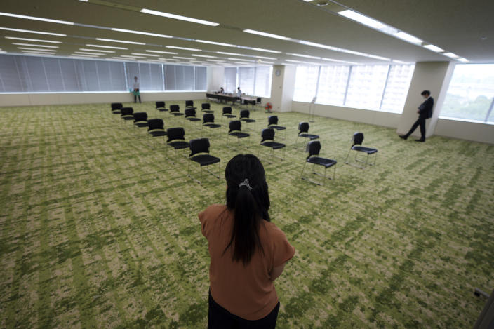 The waiting area for the Moderna's COVID-19 vaccine shot is seen at the office building of the beverage maker Suntory as the company began its workplace vaccination Monday, June 21, 2021, in Tokyo. Thousands of Japanese companies began distributing COVID-19 vaccines to workers and their families Monday in an employer-led drive reaching more than 13 million people that aims to rev up the nation's slow vaccine rollout. (AP Photo/Eugene Hoshiko)