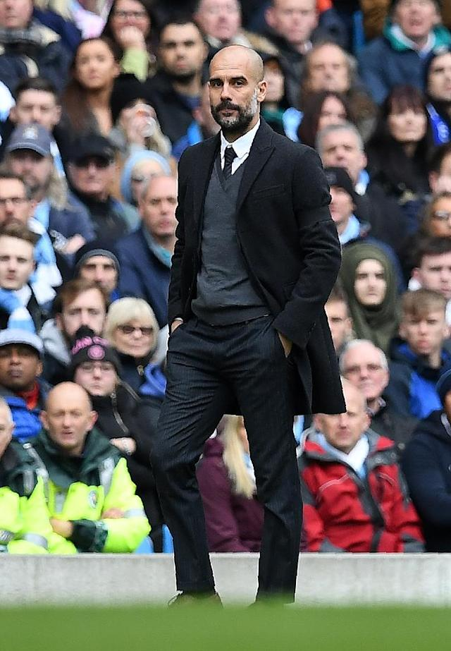 Manchester City's manager Pep Guardiola watches his players from the touchline during the English Premier League football match against Chelsea December 3, 2016 (AFP Photo/Paul ELLIS)