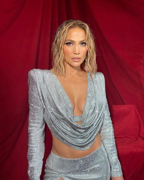 """<p>Is there any look J Lo can't work? Answer - no. The singer paired a slinky, silver Balmain outfit with a sultry wet-look bob for this year's AMA Awards. Somewhere between Flashdance and Versace SS21, Lopez's 'just out of the shower' hair looked simultaneously low-key and totally epic. As per, the hair pro behind the look was J Lo's go-to stylist, Chris Appleton who employed a pair of curling tongs and a whole lot of shine spray to achieve the mermaid-esque waves.</p><p><a href=""""https://www.instagram.com/p/CH6YliCp0on/?utm_source=ig_embed&utm_campaign=loading"""" rel=""""nofollow noopener"""" target=""""_blank"""" data-ylk=""""slk:See the original post on Instagram"""" class=""""link rapid-noclick-resp"""">See the original post on Instagram</a></p>"""