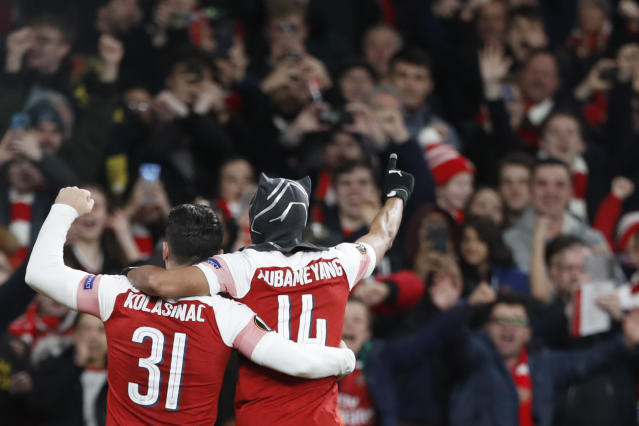 Arsenal's Pierre-Emerick Aubameyang, right, celebrates after scoring his side's third goal during the Europa League round of 16, 2nd leg, soccer match between Arsenal and Rennes at the Emirates stadium in London, Thursday, March 14, 2019. (AP Photo/Alastair Grant)