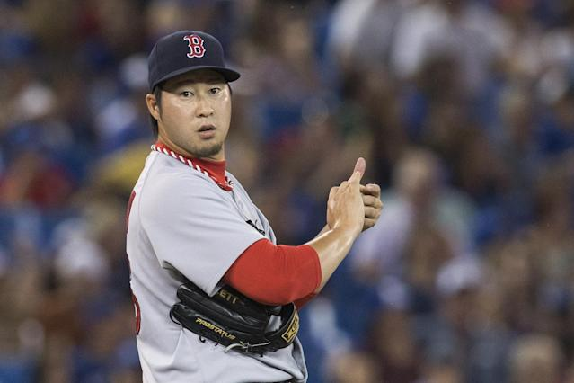 Boston Red Sox pitcher Junichi Tazawa stands on the mound as he works against the Toronto Blue Jays during the 10th inning of a baseball game Tuesday, Aug. 26, 2014, in Toronto. Boston won 11-7 in 11 innings. (AP Photo/The Canadian Press, Chris Young)