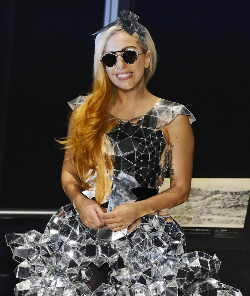 "Lady Gaga smiles as she visits the Tokyo Sky Tree, the world's tallest freestanding broadcast structure that stands 634-meter (2,080 feet), in Tokyo Tuesday, May 15, 2012. Lady Gaga might have to cancel her sold-out show in Indonesia because Islamic hard-liners and conservative lawmakers objected. National police spokesman Boy Rafli Amar said the permit was denied for the June 3, 2012, ""Born This Way"" concert that was to be the biggest show on her Asian tour. (AP Photo/Kyodo News) JAPAN OUT, MANDATORY CREDIT, NO LICENSING IN CHINA, HONG KONG, JAPAN, SOUTH KOREA AND FRANCE"