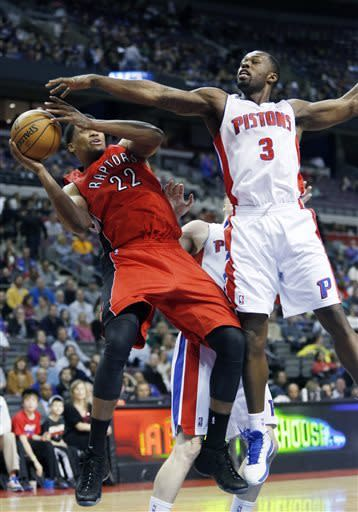 Detroit Pistons guard Rodney Stuckey (3) puts the pressure on as Toronto Raptors forward Rudy Gay (22) tries to shoot in the first half of an NBA basketball game on Friday, March 29, 2013, in Auburn Hills, Mich. (AP Photo/Duane Burleson)