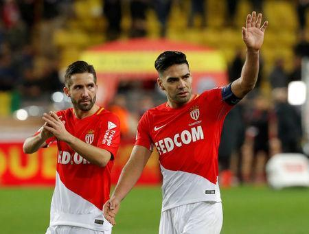 Soccer Football - Ligue 1 - AS Monaco vs Paris St Germain - Stade Louis II, Monaco - November 26, 2017 Monaco's Joao Moutinho and Radamel Falcao look dejected after the match REUTERS/Eric Gaillard