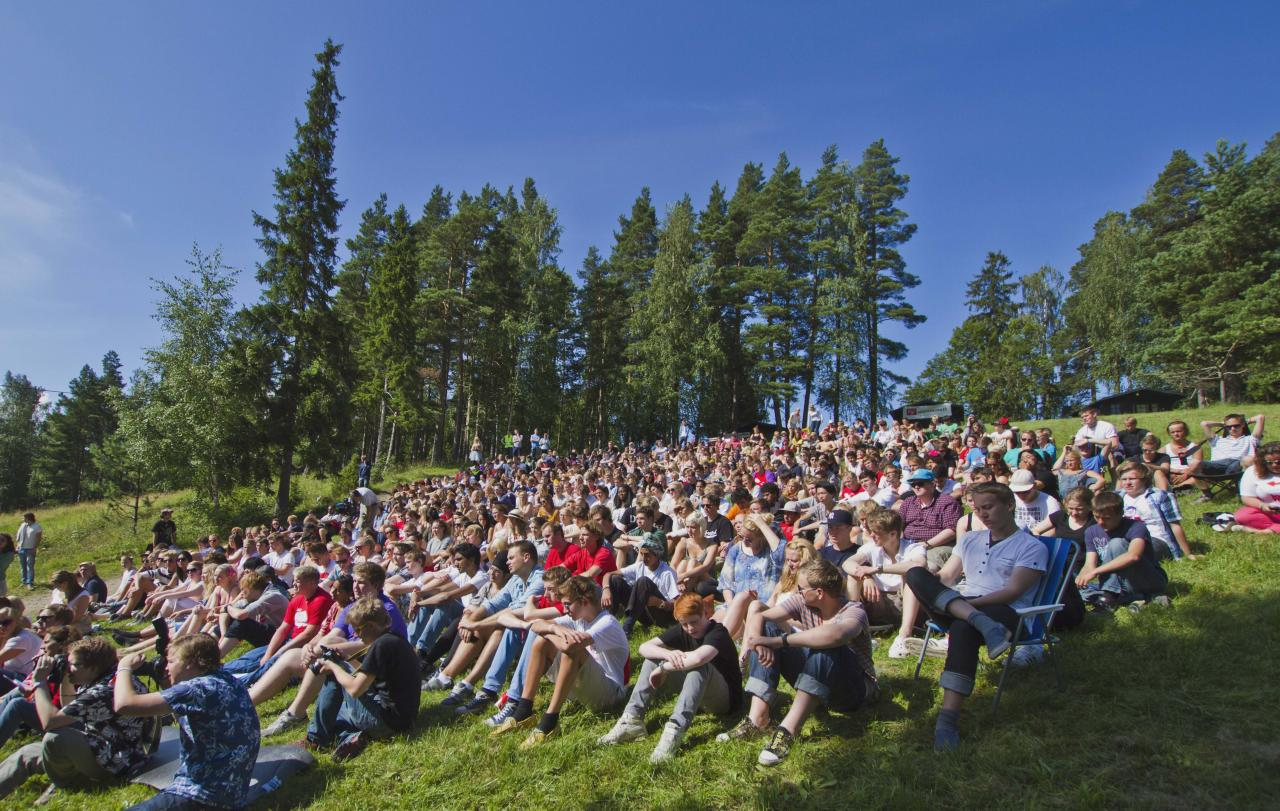 This Thursday July 21, 2011 photo shows young people on the Labour Youth League summer camp on Utoya island, Norway when Norwegian Foreign Minister Jonas Gahr Stoere made a visit. A Norwegian gunman disguised as a police officer beckoned his victims closer before shooting them one by one, claiming at least 84 lives, in a horrific killing spree on an idyllic island teeming with youths that has left this peaceful Nordic nation in mourning. The island tragedy Friday unfolded hours after a massive explosion ripped through a high-rise building housing the prime minister's office, killing seven people. (AP Photo/Scanpix/Vegard Gratt) NORWAY OUT