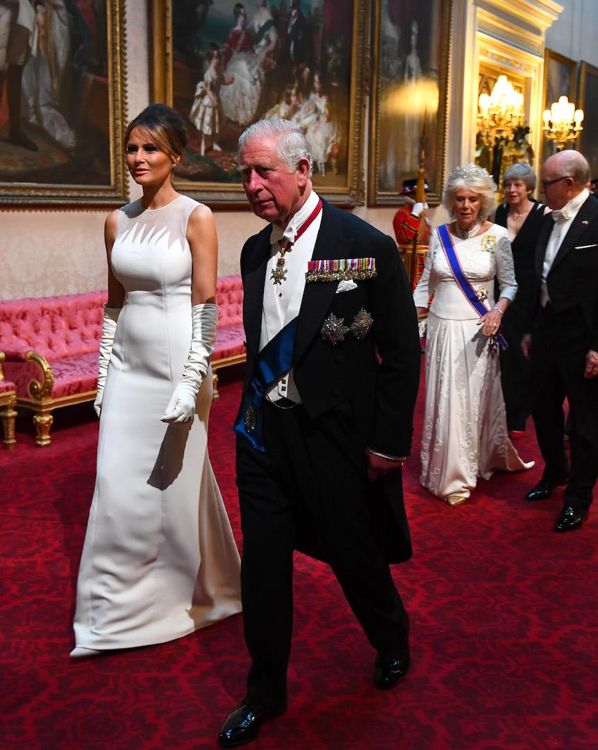 Melania Trump opted for another all-white ensemble at the state banquet on June 3. This time, she chose a sweeping Dior gown with co-ordinating elbow-high gloves. Her hair was swept back in the same chic way as earlier in the day. [Photo: Getty]