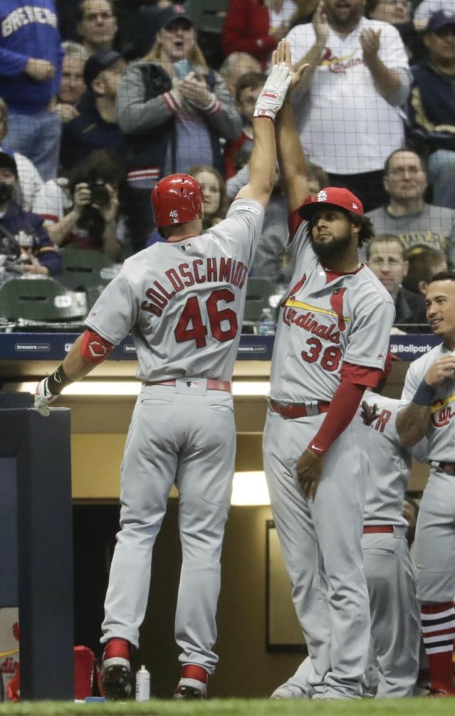St. Louis Cardinals' Paul Goldschmidt is congratulated by Jose Martinez after hitting a two-run home run during the first inning of a baseball game against the Milwaukee Brewers Friday, March 29, 2019, in Milwaukee. (AP Photo/Morry Gash)