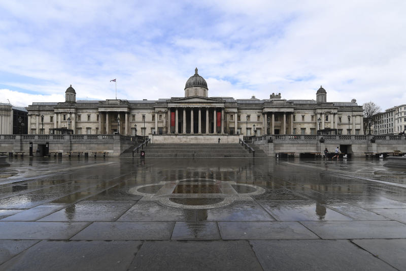 General view of The National Gallery of art, on one side of the empty Trafalgar Square, due to the Coronavirus outbreak in London, Sunday March 29, 2020. The public have been asked to self isolate, keeping distant from others to limit the spread of the contagious COVID-19 coronavirus. The new coronavirus causes mild or moderate symptoms for most people, but for some, especially older adults and people with existing health problems, it can cause more severe illness or death. (AP Photo/Alberto Pezzali)