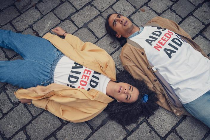 """Nathaniel Curtis as Ash Mukherjee, and Lydia West as Jill Baxter in HBO Max's """"It's A Sin,"""" a new miniseries about a group of young friends during the AIDS crisis in London."""