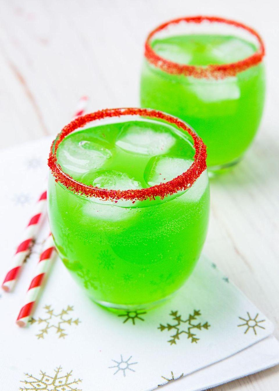 """<p>Get into the festive mood with these bright green cocktails!<br></p><p>Get the recipe from <a href=""""https://www.delish.com/holiday-recipes/christmas/a29813140/spiked-grinch-punch-recipe/"""" rel=""""nofollow noopener"""" target=""""_blank"""" data-ylk=""""slk:Delish."""" class=""""link rapid-noclick-resp"""">Delish.</a></p>"""