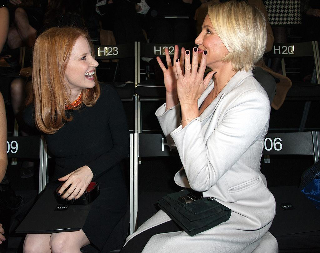 Jessica Chastain and Cameron Diaz react as Chastain learns she is nominated for an Oscar at the Giorgio Armani Prive Haute-Couture 2012 show as part of Paris Fashion Week on January 24, 2012 in Paris, France.