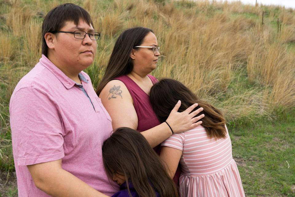 Norma LeRoy, left, and Alice Johnson hold their daughters, ages 7 and 12 in Valentine City Park on May 21. They have filed a lawsuit against Cody-Kilgore Unified Schools, alleging that their daughters' hair was cut in violation of Lakota religious and cultural beliefs and their civil rights.