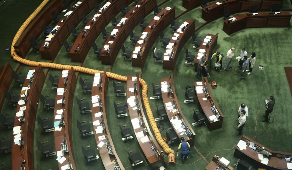 A ventilation pipe is placed on walkways at the main chamber of the Legislative Council after an opposition lawmaker dropped a pot of pungent liquid in the chamber. Photo: Nora Tam