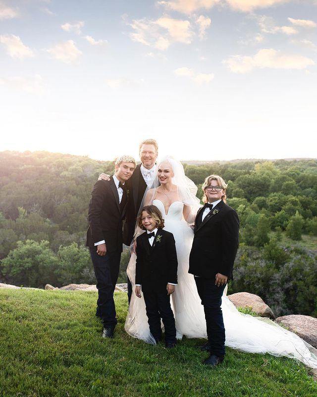 """<p>The bride wore a sweetheart Vera Wang gown with a fitted bodice and a floor-length tulle skirt for her Oklahoma wedding to Shelton. She also had a chapel-length veil which was embroidered with her first name, in addition to her husband's and her three sons': Kingston James McGregor, 15, Zuma Nesta Rock, 12, and Apollo Bowie Flynn, seven. </p><p><a href=""""https://www.instagram.com/p/CRB2gXGj-GD/"""" rel=""""nofollow noopener"""" target=""""_blank"""" data-ylk=""""slk:See the original post on Instagram"""" class=""""link rapid-noclick-resp"""">See the original post on Instagram</a></p>"""