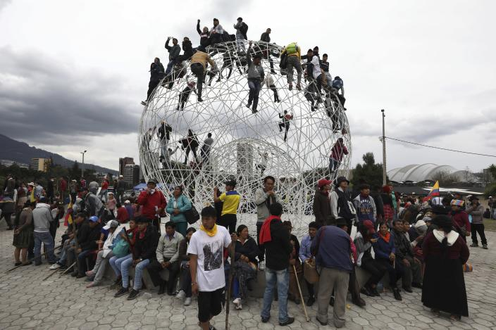 Anti-government demonstrators gather in El Arbolito Park to march against President Lenin Moreno and his economic policies in Quito, Ecuador, Tuesday, Oct. 8, 2019. The protests, which began when Moreno's decision to cut subsidies led to a sharp increase in fuel prices, have persisted for days and clashes led the president to move his besieged administration out of Quito. (AP Photo/Fernando Vergara)