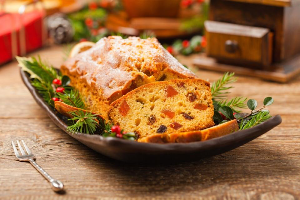 christmas fruitcake in dish on wooden table
