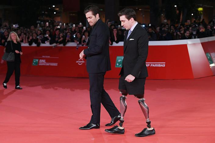 """<span class=""""caption"""">Jake Gyllenhaal and Jeff Bauman walk a red carpet for 'Stronger' during the 12th Rome Film Fest on Oct. 28, 2017.</span> <span class=""""attribution""""><a class=""""link rapid-noclick-resp"""" href=""""https://www.gettyimages.com/detail/news-photo/jake-gyllenhaal-and-jeff-bauman-walk-a-red-carpet-for-news-photo/867511424?adppopup=true"""" rel=""""nofollow noopener"""" target=""""_blank"""" data-ylk=""""slk:Venturelli/WireImage"""">Venturelli/WireImage</a></span>"""