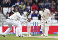 England's Ollie Robinson, right, plays a shot during the third day of third test cricket match between England and India, at Headingley cricket ground in Leeds, England, Friday, Aug. 27, 2021. (AP Photo/Jon Super)