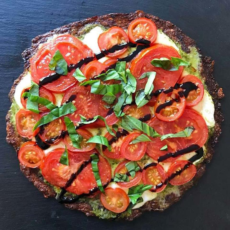 """<p>This salad pizza recipe has all the latest food trends in one tasty meal—cauliflower crust, and salad on top of pizza. The secret to a good Caprese salad is a balsamic vinegar glaze and this one adds a healthy drizzle as the final step.</p> <p><strong>Get the recipe:</strong> <a rel=""""nofollow"""" href=""""https://www.healthygffamily.com/recipe/grilled-caprese-cauliflower-pizza-3/"""">Grilled Caprese Cauliflower Pizza</a></p>"""