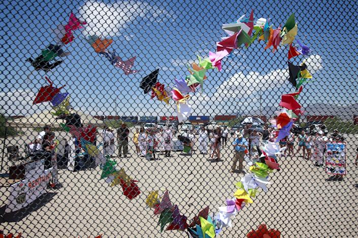Paper doves in the shape of a heart are seen at the border fence in Ciudad Juarez, Mexico.