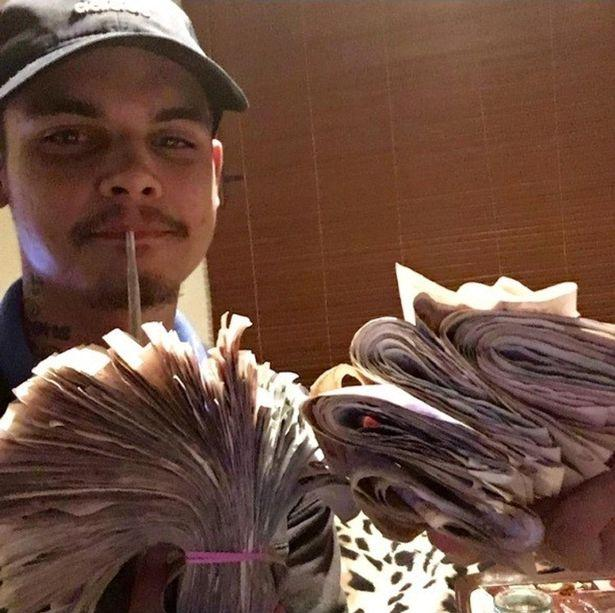 Jauncey holds a wad money (Picture: SWNS)