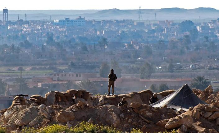 A Syrian Democratic Forces fighter keeps watch during an operation to expel hundreds of Islamic State group jihadists from their last redoubt (AFP Photo/Fadel SENNA)