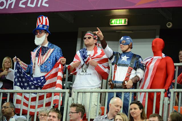 LONDON, ENGLAND - JULY 28: USA fans celebrate versus Croatia at the Olympic Park Basketball Arena during the London Olympic Games on July 28, 2012 in London, England. NOTE TO USER: User expressly acknowledges and agrees that, by downloading and/or using this Photograph, user is consenting to the terms and conditions of the Getty Images License Agreement. Mandatory Copyright Notice: Copyright 2012 NBAE (Photo by Garrett W. Ellwood/NBAE via Getty Images)