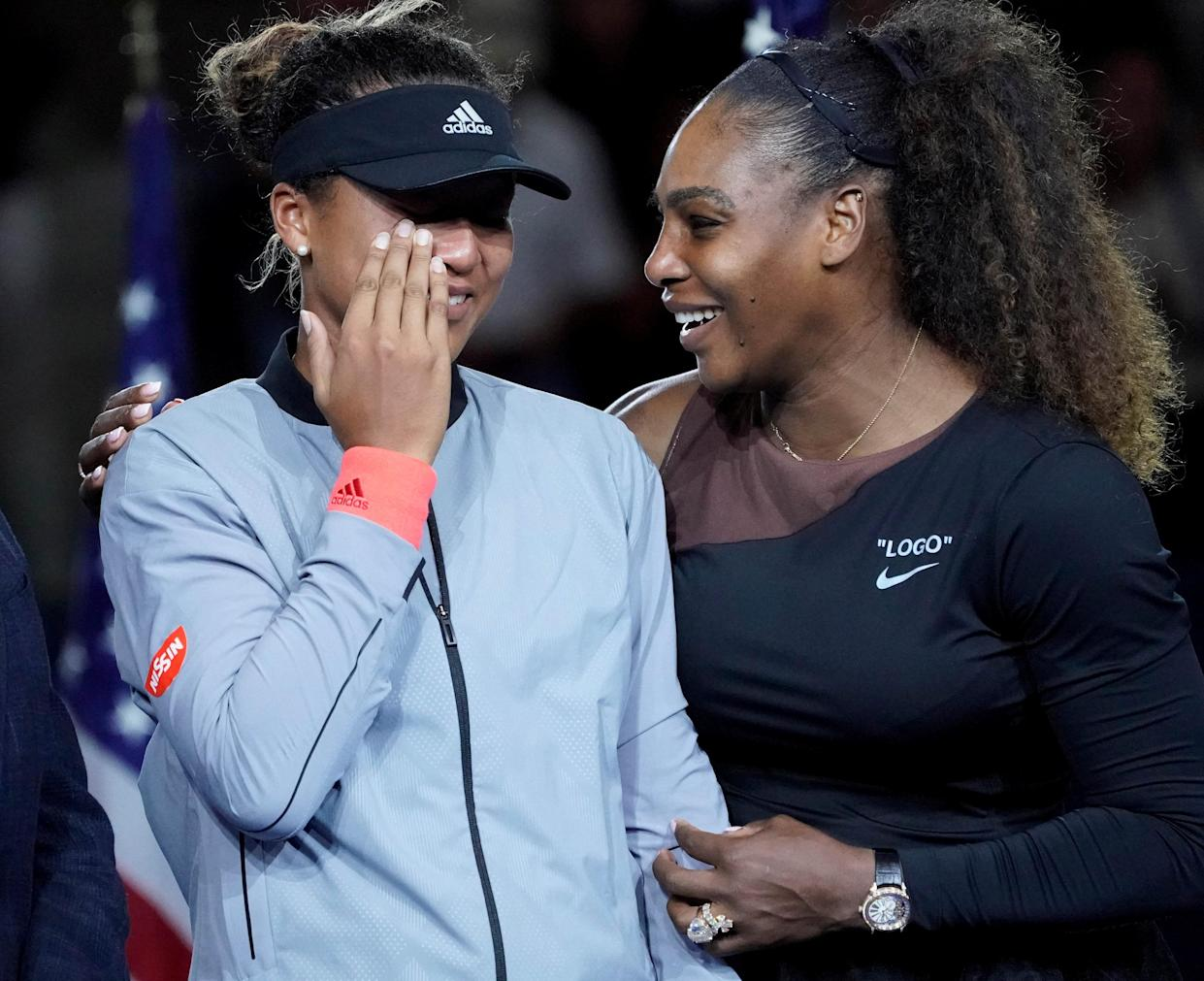 Naomi Osaka of Japan (left) cries as Serena Williams of the USA comforts her after the crowd booed during the trophy ceremony following the women's final on day thirteen of the 2018 U.S. Open tennis tournament. Osaka defeated Williams in the women's final of the U.S. Open. Credit: Robert Deutsch-USA TODAY Sports TPX IMAGES OF THE DAY