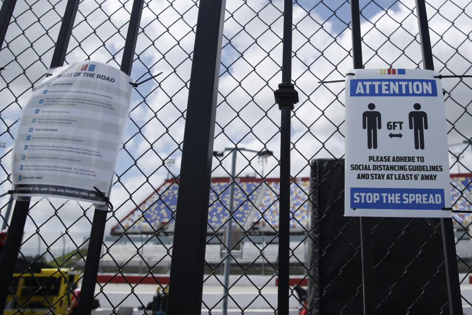 Social distancing guidelines are posted at Darlington Raceway Sunday, May 17, 2020, in Darlington, S.C. NASCAR, which has been idle for 10 weeks because of the coronavirus pandemic, makes its return with the Real Heroes 400 Nascar Cup Series auto race Sunday. (AP Photo/Brynn Anderson)