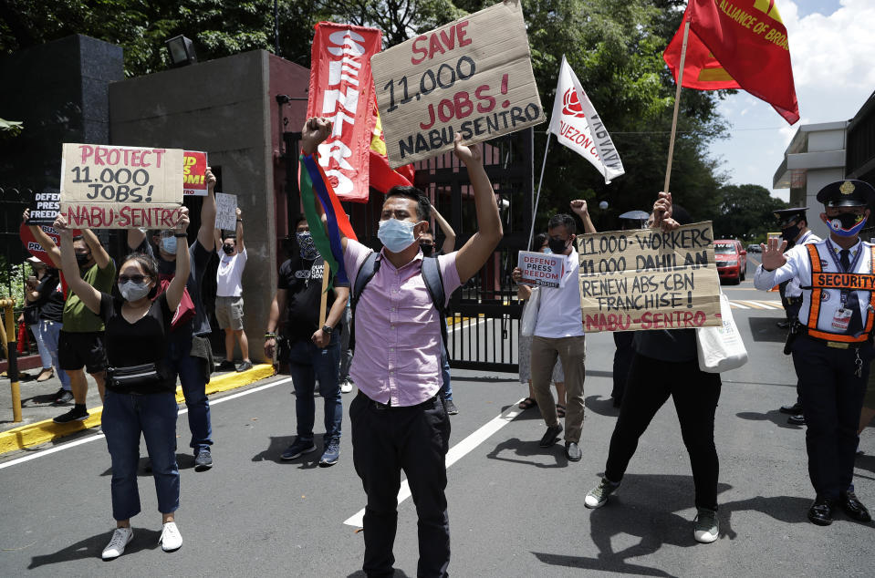 Supporters of the country's largest TV network ABS-CBN shout slogans during a rally outside the House of Representatives in metropolitan Manila, Philippines on Thursday, July 9, 2020. ABS-CBN was shut down by the government's telecommunications regulator in May after its 25-year franchise expired. Congress has been hearing the network's request for a franchise renewal. The shutdown has been criticized as it cut off a major source of information on the COVID-19 pandemic in a Southeast Asian hot spot of the disease. (AP Photo/Aaron Favila)
