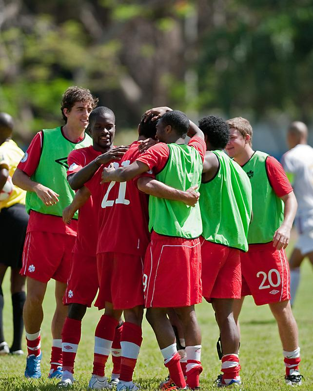 Canadian national football team's players celebrate their victory  over Cuba after their FIFA World Cup Brazil 2014 CONCACAF qualifier match at the Pedro Marrero stadium in Havana on June 8, 2012. Canada won 1-0.   AFP PHOTO/STRSTR/AFP/GettyImages