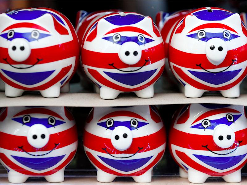 Smiling Union Jack piggy banks are lined up for sale in the window of a souvenir store on Oxford Street in central London January 20, 2014.