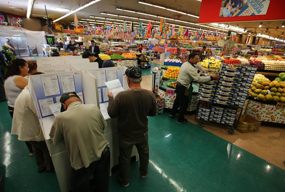 Voters in a grocery store in National City, California.