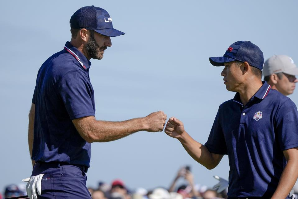Team USA's Dustin Johnson and Team USA's Collin Morikawa celebrate on the 15th hole during a foursomes match the Ryder Cup at the Whistling Straits Golf Course Saturday, Sept. 25, 2021, in Sheboygan, Wis. (AP Photo/Charlie Neibergall)