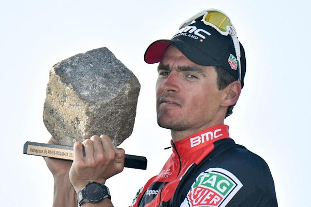 Belgium's Greg Van Avermaet holds his trophy as he celebrates on the podium after winning the 115th edition of the Paris-Roubaix one-day classic cycling race, between Compiegne and Roubaix, on April 9, 2017 in Roubaix, northern France (AFP Photo/PHILIPPE LOPEZ)