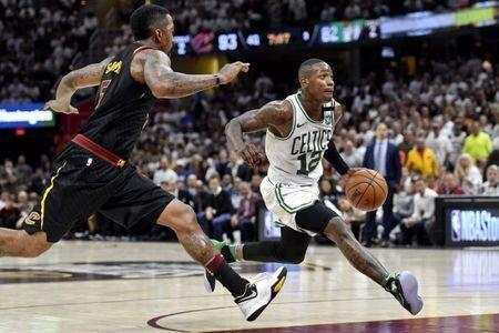 May 25, 2018; Cleveland, OH, USA; Boston Celtics guard Terry Rozier (12) drives to the basket against Cleveland Cavaliers guard JR Smith (5) during the fourth quarter in game six of the Eastern conference finals of the 2018 NBA Playoffs at Quicken Loans Arena. Mandatory Credit: David Richard-USA TODAY Sports