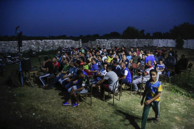Egyptian fans gather to watch the group A World Cup match between Egypt and Russia at a cafe in the hometown of Liverpool star striker Mohammed Salah, in the Nile delta village of Nagrig, Egypt, Tuesday, June 19, 2018. (AP Photo/Islam Safwat)