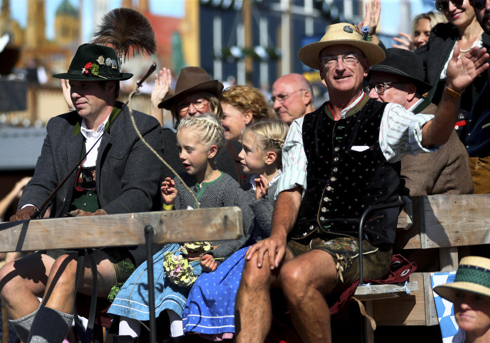People in traditional costumes take part in a parade as part of the opening of the 186th 'Oktoberfest' beer festival in Munich, Germany, Saturday, Sept. 21, 2019. (AP Photo/Matthias Schrader)