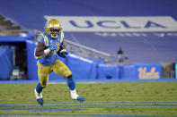 UCLA running back Demetric Felton Jr. carries against Arizona during the second half of an NCAA college football game Saturday, Nov. 28, 2020, in Pasadena, Calif. (AP Photo/Marcio Jose Sanchez)