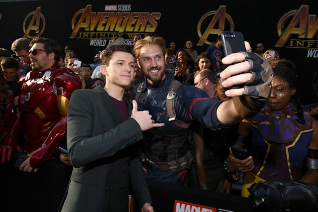 Tom Holland takes the snap. (Getty Images)