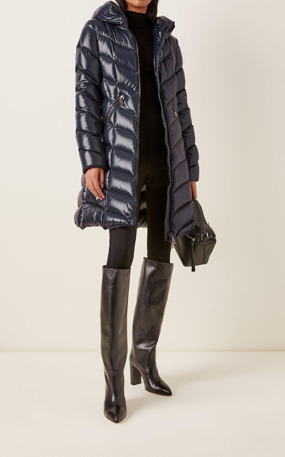 <p>Get cozy with this useful <span>Moncler Marus Hooded Long Down Puffer Coat</span> ($1,740).</p>