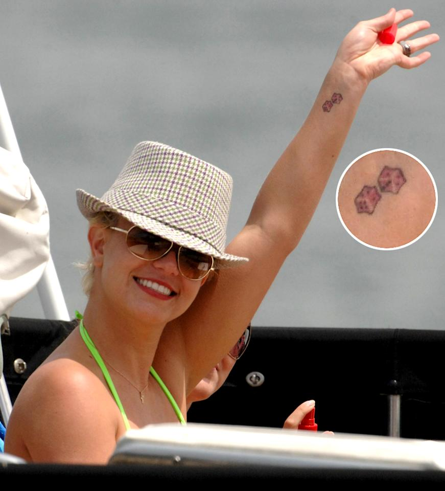 Britney Spears is seen in a mutli-coloured bikini, smoking on the top deck of a luxury motor yacht in Los Angeles today. Britney, who had arrived earlier with her friend Allie, two bodyguards, both sons and a nanny, seemed to be enjoying herself and gave a big wave to the cameras. After a two-hour cruise, on her departure form the boat she donned a captains hat and a pink wrap-around whilst sipping a cup of coffee on her way back to her waiting car. 