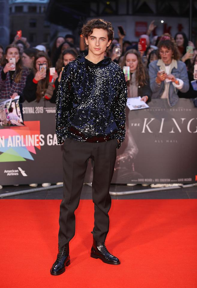 """<p>Timothée wore <a href=""""https://www.popsugar.com/fashion/timothée-chalamet-at-king-uk-premiere-pictures-46716126"""" class=""""ga-track"""" data-ga-category=""""Related"""" data-ga-label=""""https://www.popsugar.com/fashion/timoth%C3%A9e-chalamet-at-king-uk-premiere-pictures-46716126"""" data-ga-action=""""In-Line Links"""">a glimmering Louis Vuitton hoodie</a> to the UK premiere of <strong>The King</strong> at the BFI London Film Festival.</p>"""