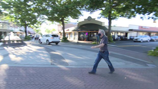 Rick Steves strolls the streets of Edmonds, Wash., 5,650 miles from Rome. / Credit: CBS News
