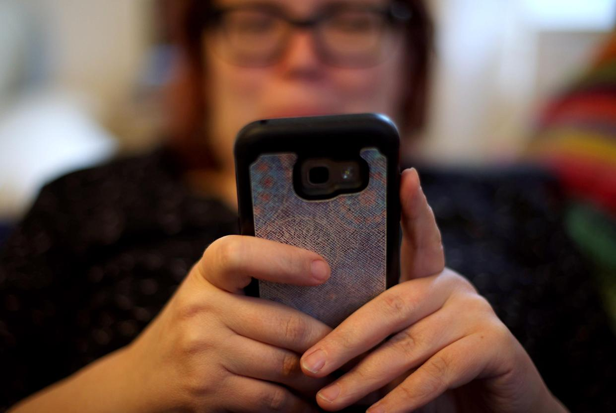 File photo dated 08/05/19 of a woman using her mobile phone. Impersonation scam cases more than doubled in the first half of 2021 to 33,115, a finance industry trade association has said. Issue date: Monday September 13, 2021.