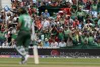Bangladesh fans celebrate a four from Bangladesh's Shakib Al Hasan, foreground, during the Cricket World Cup match between South Africa and Bangladesh at the Oval in London, Sunday, June 2, 2019. (AP Photo/Matt Dunham)
